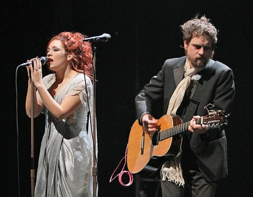 """David Poe and Holly Brook are singing ghosts in """"Whisper House,"""" now playing at the Old Globe Theatre in Balboa Park."""