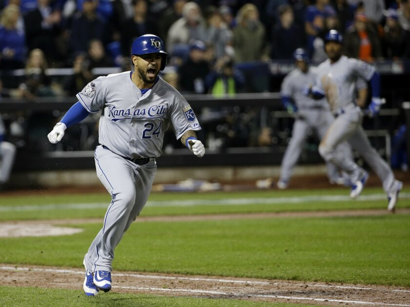 Kansas City Royals' Christian Colon reacts after hitting an RBI single during the 12th inning of Game 5 of the Major League Baseball World Series against the New York Mets Monday, Nov. 2, 2015, in New York. (AP Photo/David J. Phillip)