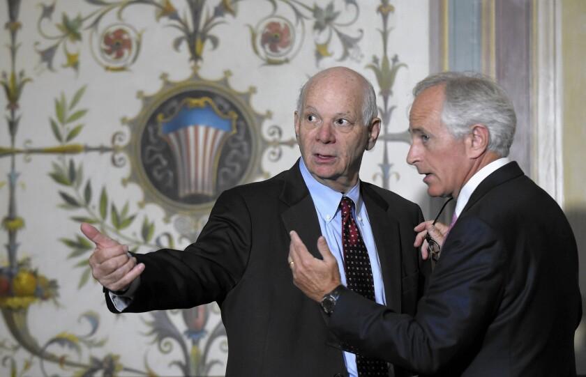 Sen. Benjamin Cardin (D-Md.), left, and Sen. Bob Corker (R-Tenn.) talk on Capitol Hill on July 16 after Vice President Joe Biden met with senators to push the Iran nuclear deal.