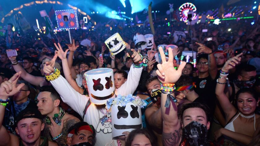 Fans dance at the Electric Daisy Carnival at Las Vegas Motor Speedway on Sunday.