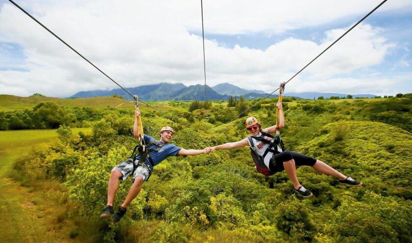 Riding the zip line on Kauai.