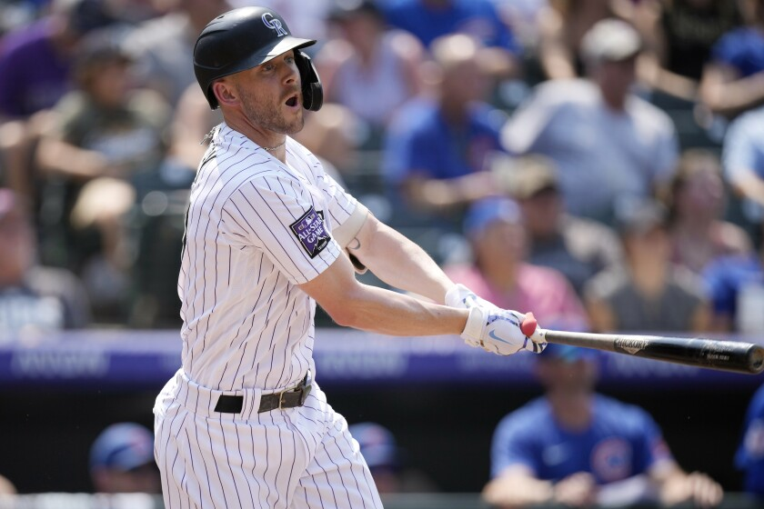 Colorado Rockies' Trevor Story follows the flgiht of his two-run home run off Chicago Cubs relief pitcher Jake Jewell in the fifth inning of a baseball game Thursday, Aug. 5, 2021, in Denver. (AP Photo/David Zalubowski)
