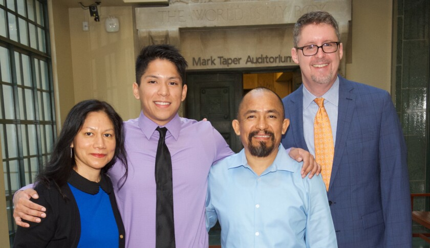 Left to right: Francisca, Bryan and Sergio Sanchez and Los Angeles Public Library city librarian John F. Szabo