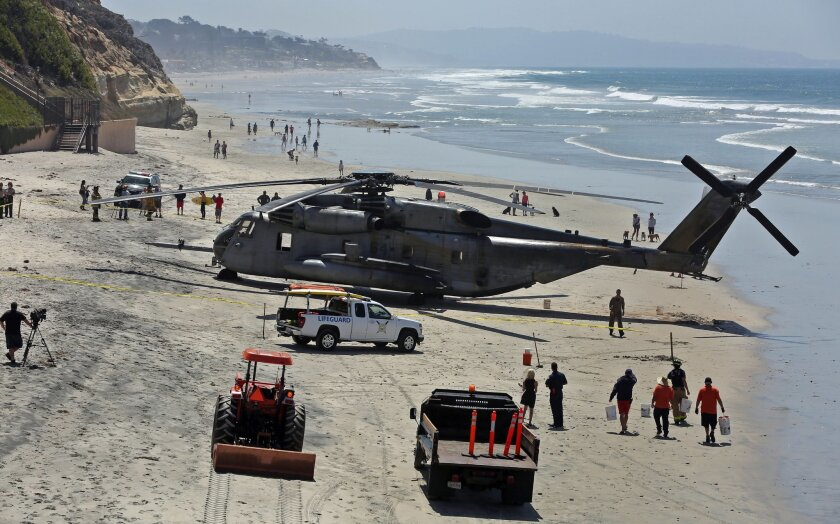 A Marine helicopter on the beach in south Solana Beach Wednesday after making an emergency landing. No one was injured.