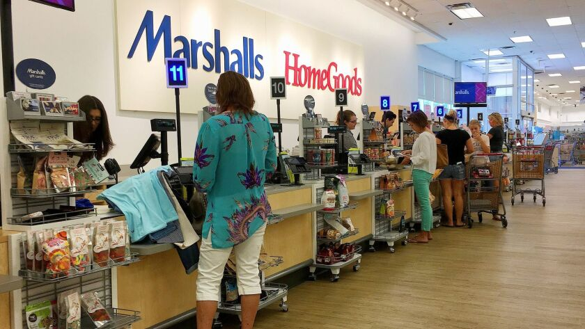 Shoppers pay for their purchases at a Marshalls and Home Goods store in Phoenix in May.