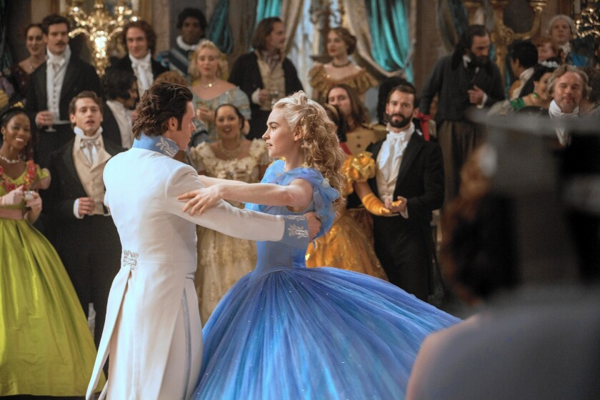 "Lily James as Cinderella and Richard Madden as the Prince take a spin around the ballroom in the live-action ""Cinderella."""