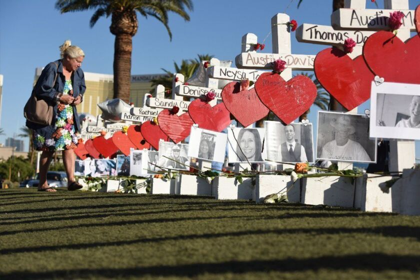 In this photo taken on October 06, 2017 Las Vegas resident Nancy Hardy visits the 58 white crosses for the victims of the mass shooting, on Las Vegas Strip just south of the Mandalay Bay hotel in Las Vegas, Nevada.