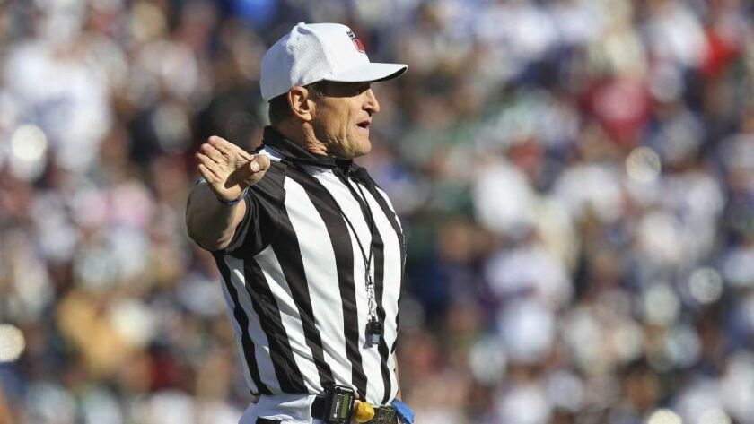 Retired NFL referee Ed Hochuli has sold one of two condos he owns in San Diego for $2.395 million.