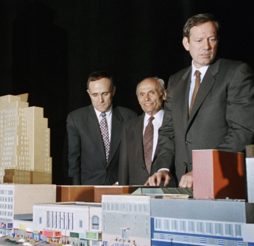 FILE - In this May 1, 1995 file photo, New York City Mayor Rudolph Giuliani, left, developer John Tishman, center, and Gov. George Pataki, pose with the scale model of the plan for the 42nd Street development project in New York. Tishman, a builder whose company has worked on some of the most high-