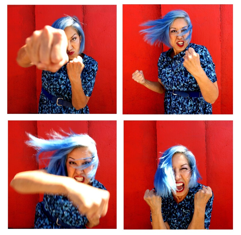 Four photos of Alice Bag, two of her punching forward and two of her holding her fists up.