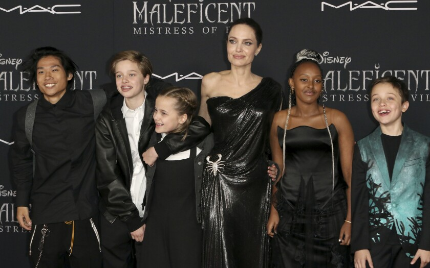 "Angelina Jolie with her children at the Hollywood premiere of ""Maleficent: Mistress of Evil."""
