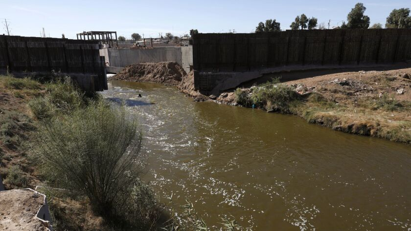 The New River flows a 30-foot gap in the U.S.-Mexico border fence.