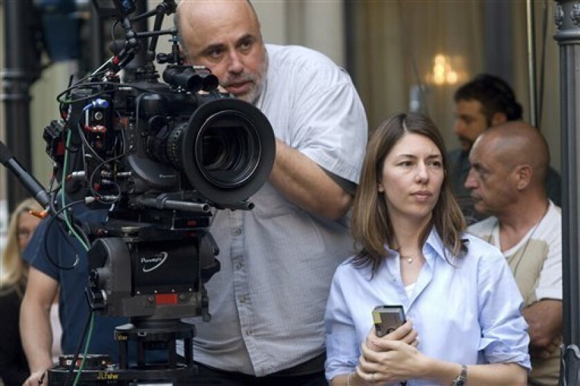 "FILE - In this film publicity file image released by Focus Features, Director of photography Harris Savides, left, and director Sofia Coppola work on the set of ""Somewhere."" Savides, an acclaimed cinematographer who worked frequently with Gus Van Sant and David Fincher, died Wednesday night, Oct. 10, 2012, his representatives at The Skouras Agency confirmed Thursday. He was 55. (AP Photo/Focus Features, Franco Biciocchi, File)"