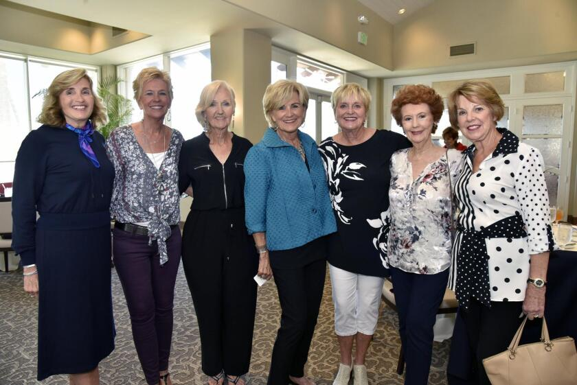 Fashion show commentator Cherie Ryan, with models Sandy Bieker, Mary Baumgartner, Carole Kaiser, Gayle Beasley, Darlene Denver, and Judy Anderson