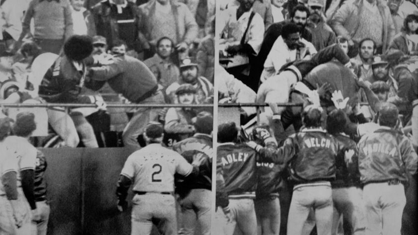 Reggie Smith goes into the stands at Candlestick Park to fight a fan who threw a batting helmet at him.