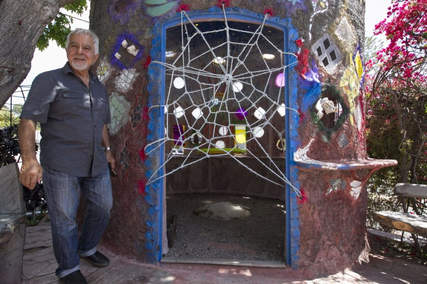 "La Jolla artist Nasser Pirasteh, whose artwork has been ordered removed by the City, with his sculpture ""In Out""."