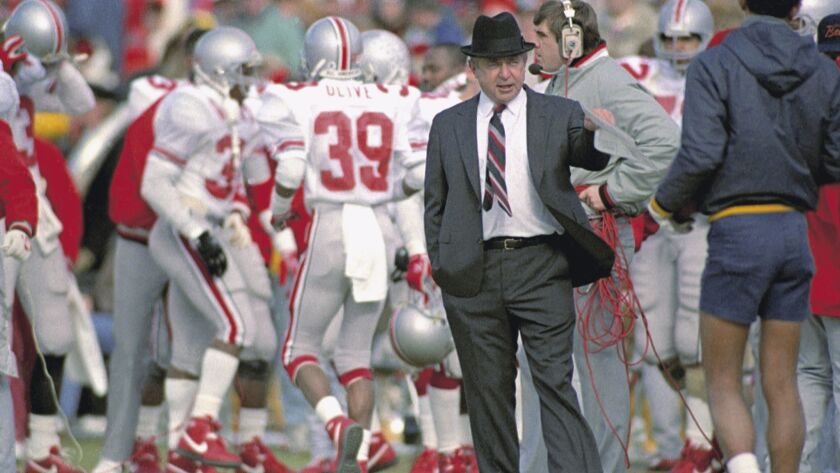 FILE - In this Nov. 21, 1987, file photo, Ohio State head coach Earle Bruce gestures on the sideline