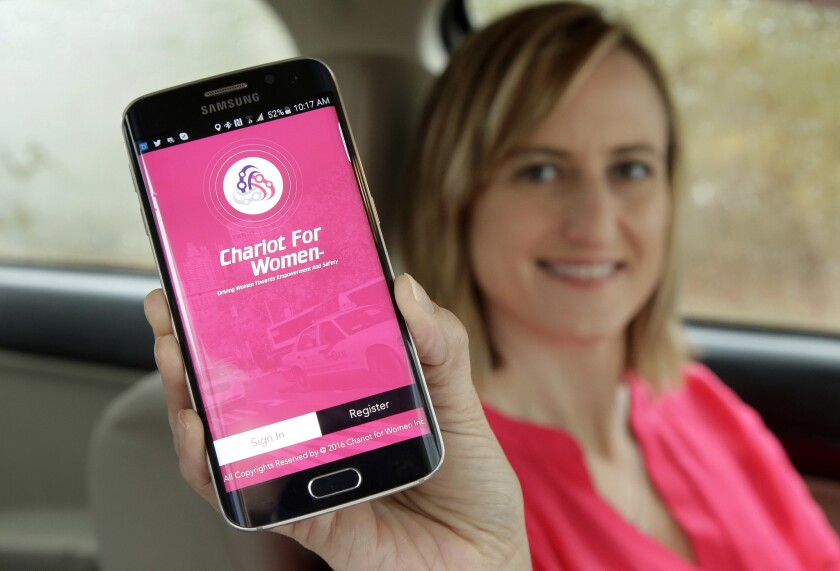 Kelly Pelletz, co-creator of the ride-hailing service Chariot for Women, displays the app on a mobile phone.