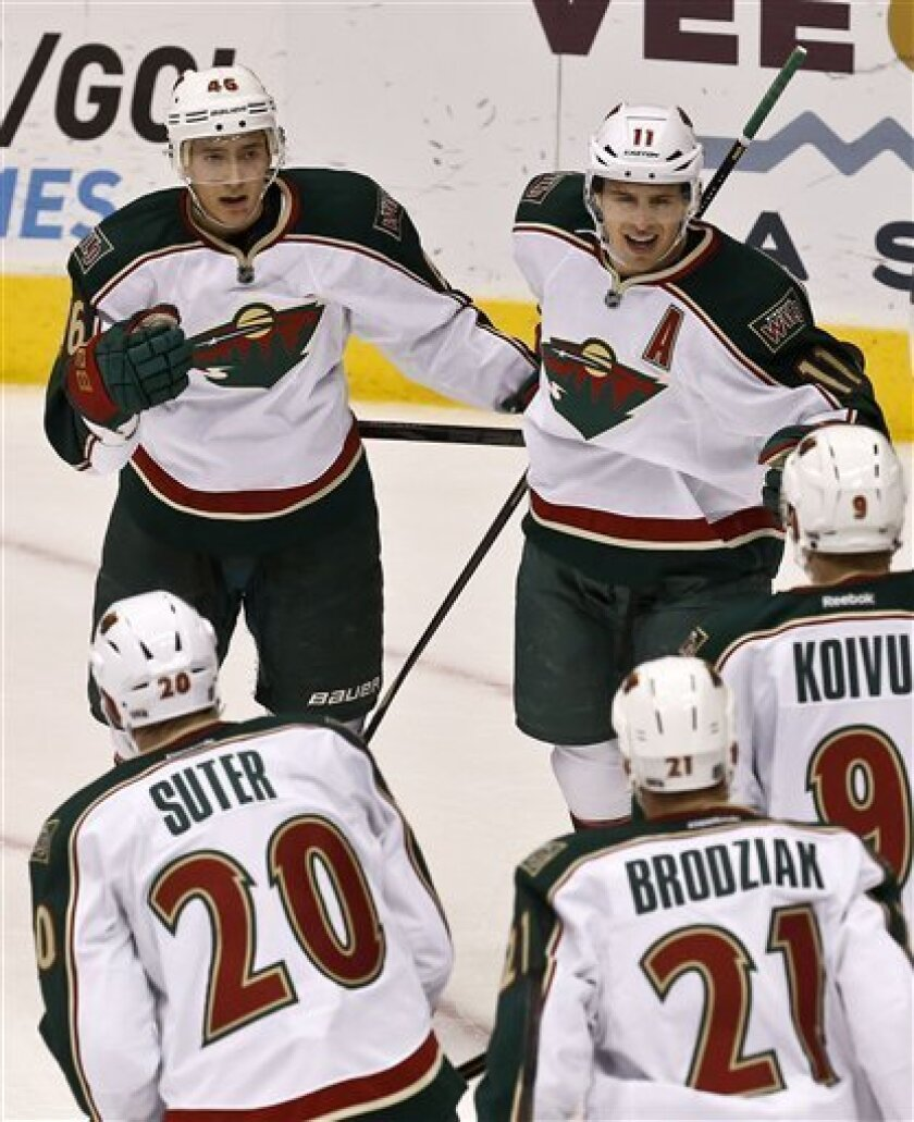 Minnesota Wild's Jared Spurgeon (46) celebrates his goal against the Phoenix Coyotes with teammates Ryan Suter (20), Kyle Brodziak (21), Mikko Koivu (9), of Finland, and Zach Parise (11) during the second period in an NHL hockey game, Thursday, Feb. 28, 2013, in Glendale, Ariz. (AP Photo/Ross D. Fr