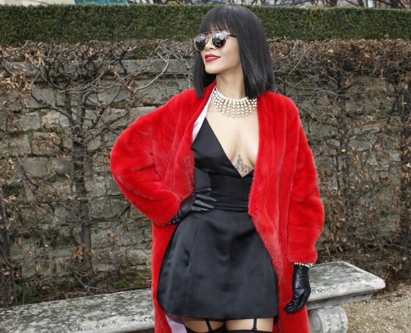 Singer Rihanna poses for photographers before Dior's ready-to-wear fall/winter 2014-2015 fashion collection presented in Paris, Friday, Feb.28, 2014. (AP Photo/Thibault Camus)