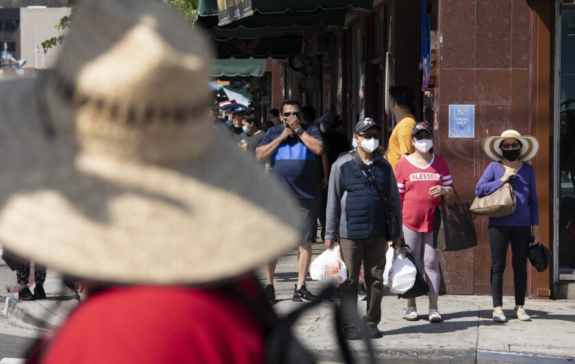 Visitors to Chinatown wear masks