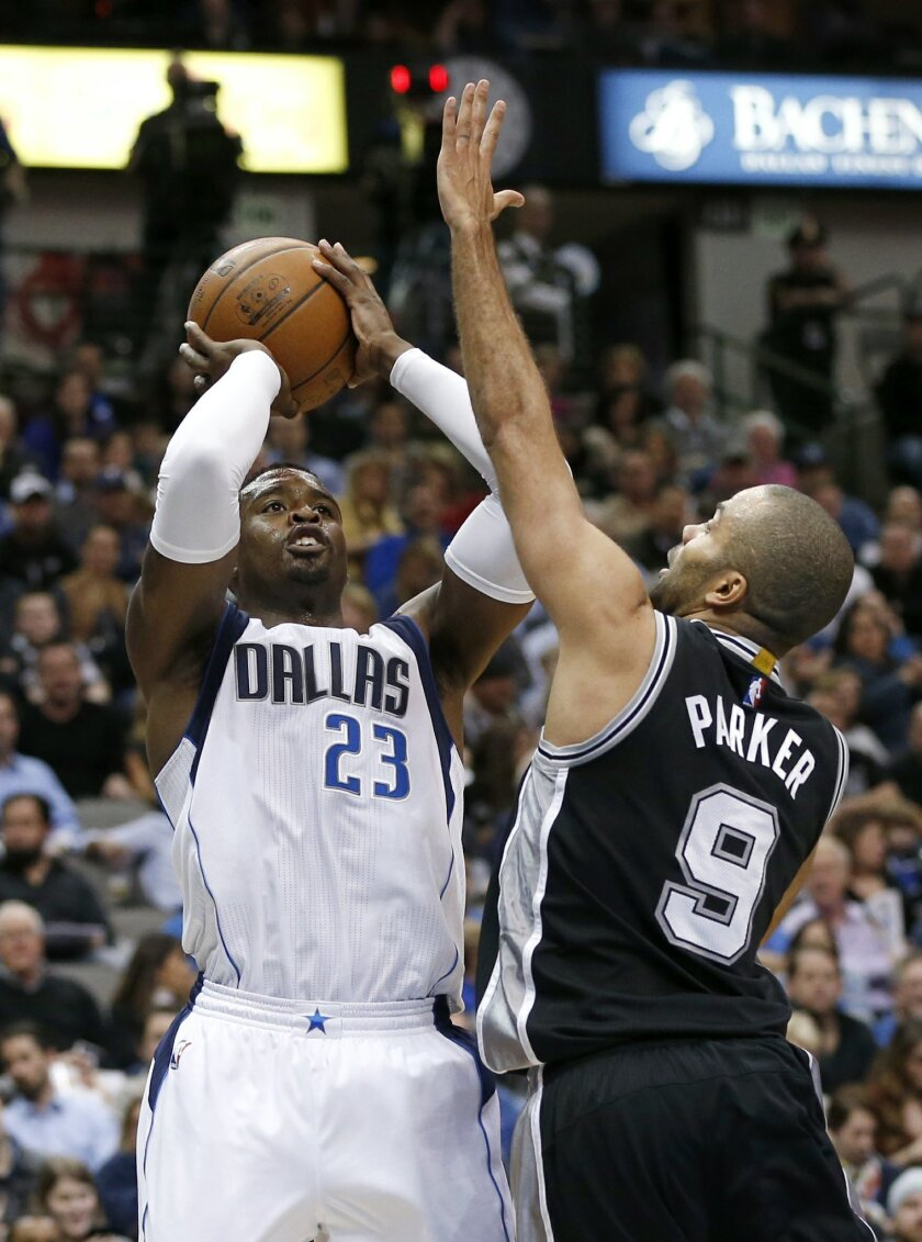"""FILE - In this Feb. 5, 2016, file photo, Dallas Mavericks guard Wesley Matthews (23) attempts a shot as San Antonio Spurs' Tony Parker (9) defends during the first half of an NBA basketball game, in Dallas. """"The state of the team? I like the team,"""" said coach RickCarlisle said. """"Who would have thou"""