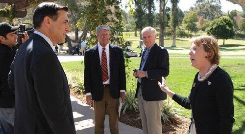 Congressman Darrell Issa is met by a representative of the RSF Republican Women. Photo: Jon Clark