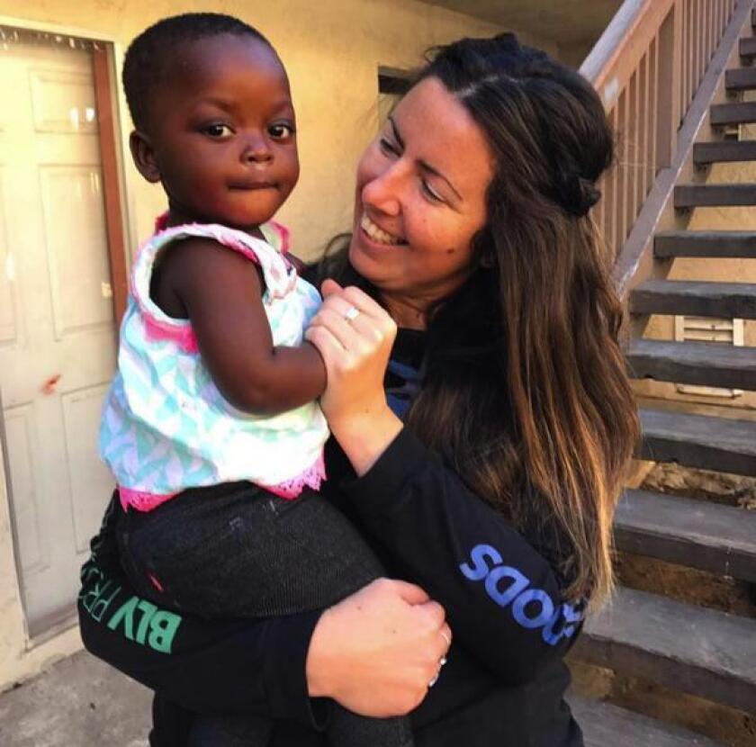 Bettina Hanna with a refugee from the Congo