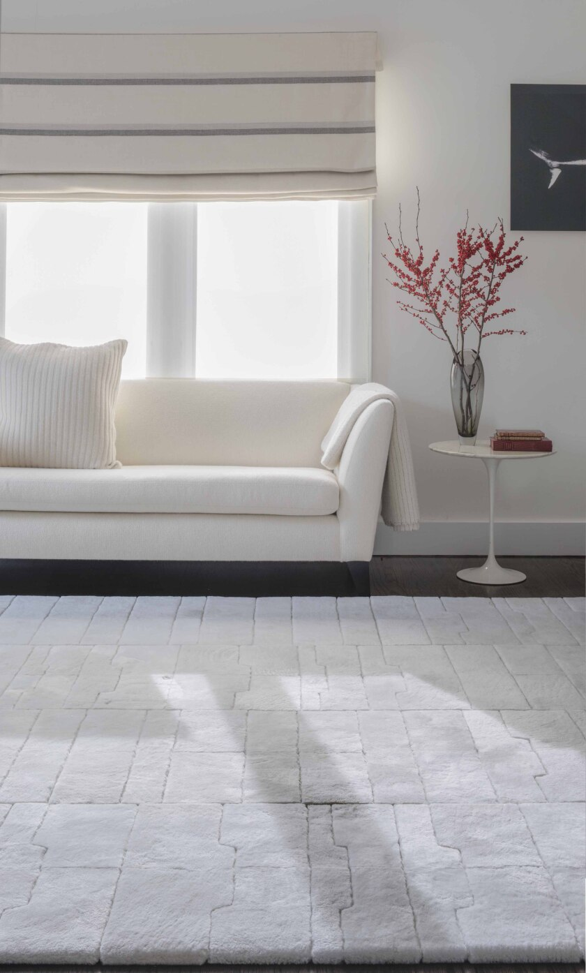Rosemary Hallgarten's art deco-inspired 1920 rug, in soft shearling in Ermine color, is at Thomas Lavin showrooms.