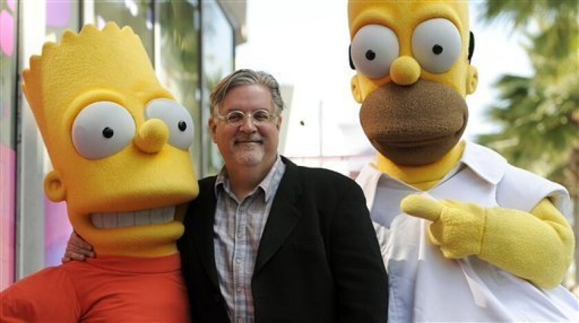 "FILE - In this Feb. 14, 2012 file photo, Matt Groening, creator of the animated series ""The Simpsons,"" poses with his character creations Bart Simpson, left, and Homer Simpson after he received a star on the Hollywood Walk of Fame in Los Angeles. One of the best-kept secrets in television history h"