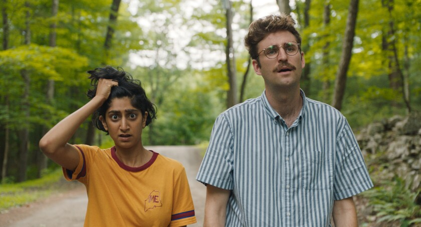 "This image released by Bleecker Street shows Sunita Mani, left, and John Reynolds in a scene from ""Save Yourselves!"" (Bleecker Street via AP)"