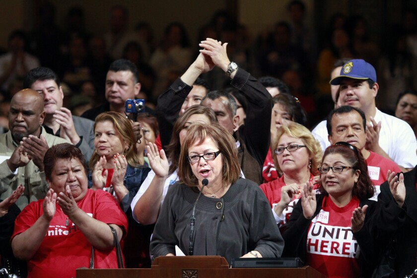 Maria Elena Durazo, seen speaking, heads the County Federation of Labor. Durazo is frustrated that the mayor's race has failed to focus on many of the issues she considers central to life in Los Angeles, including income inequality and widespread poverty among city residents.