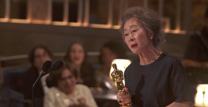 """""""Minari"""" actress Yuh-Jung Youn accepts her Oscar."""
