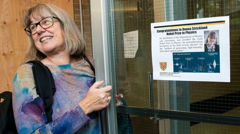Donna Strickland, an associate physics professor at the University of Waterloo, enters the university's physics building after being awarded the 2018 Nobel Prize for Physics in Waterloo, Canada on Oct. 2.