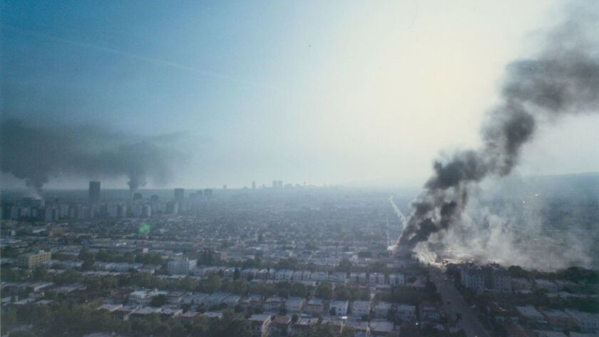 Smoke rises from Midtown Los Angeles building fires during the 1992 L.A. riots.