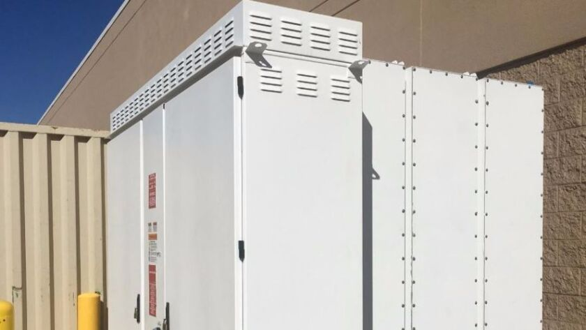 A 200 kilowatt/400 kilowatt-hour lithium-ion battery by Tesla Energy is part of a solar-plus-storage system installed at the WalMart Superstore in Poway.