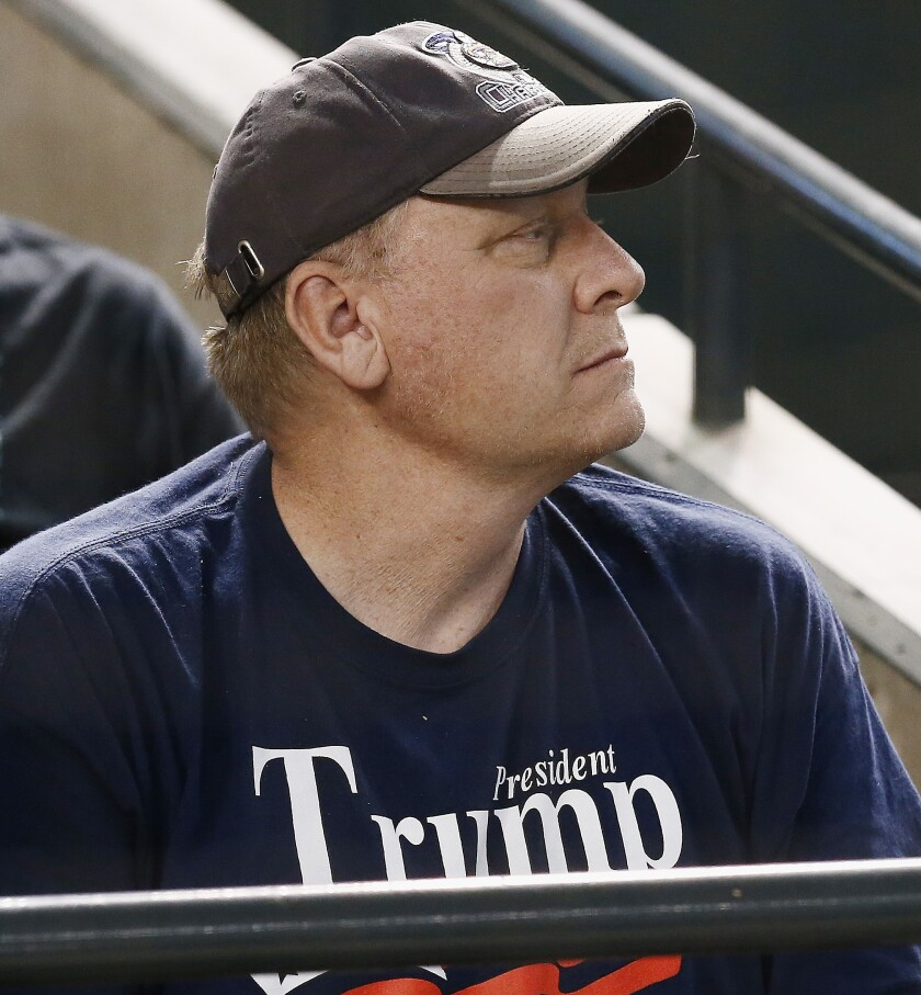 Former pitcher Curt Schilling watches a game between the Arizona Diamondbacks and the San Francisco Giants in 2018