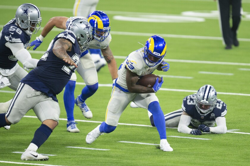 Rams running back Cam Akers carries the ball against the Cowboys on Sept. 13, 2020.