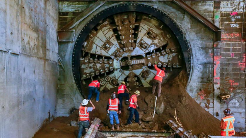 The tunnel-boring machine for the Crenshaw/LAX Line breaks through into the future site of the Leimert Park station in South Los Angeles in October. The 8.5-mile route will connect the Expo Line to the Green Line.