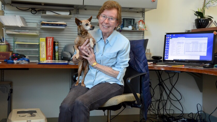 Friends of OASIS employee, Eleanor Anderson enjoys bringing her dog Lexi to work at Corona del Mar Senior Center.