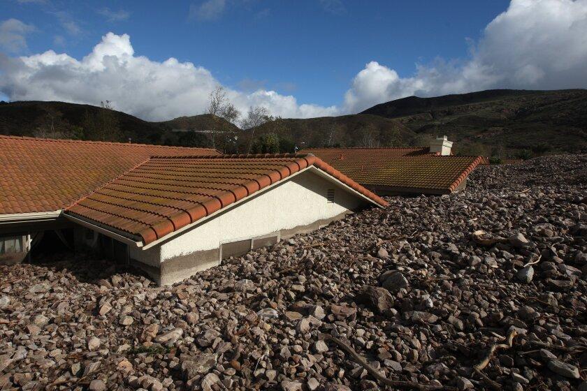 A powerful storm swept rocks and mud debris into a neighborhood in Camarillo Springs on Dec. 12, 2014, leaving 10 houses uninhabitable.