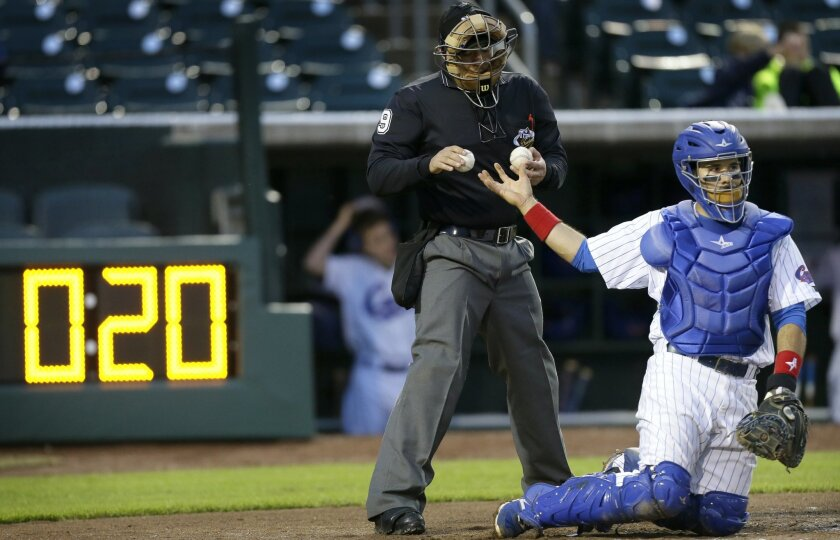 Pace of play clocks placed behind home plate and in the vicinity of the scoreboard at stadiums serve as a reminder for players to keep things moving between innings and pitches. (AP Photo/Charlie Neibergall)