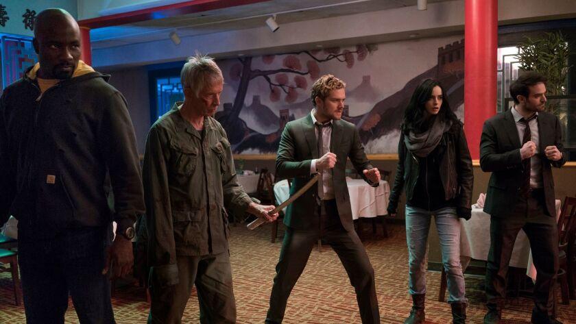 """Luke Cage (Mike Colter), from left, Stick (Scott Glenn), Iron Fist (Finn Jones), Jessica Jones (Krysten Ritter) and Daredevil (Charlie Cox) in """"Marvel's The Defenders."""""""