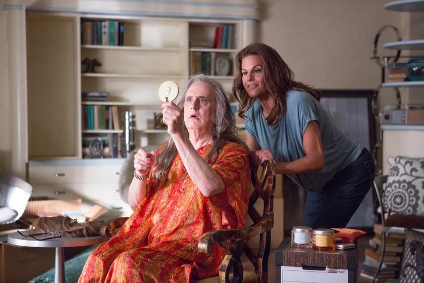 "Jeffrey Tambor, left, as Maura, Alexandra Billings as Davina in ""Transparent."""