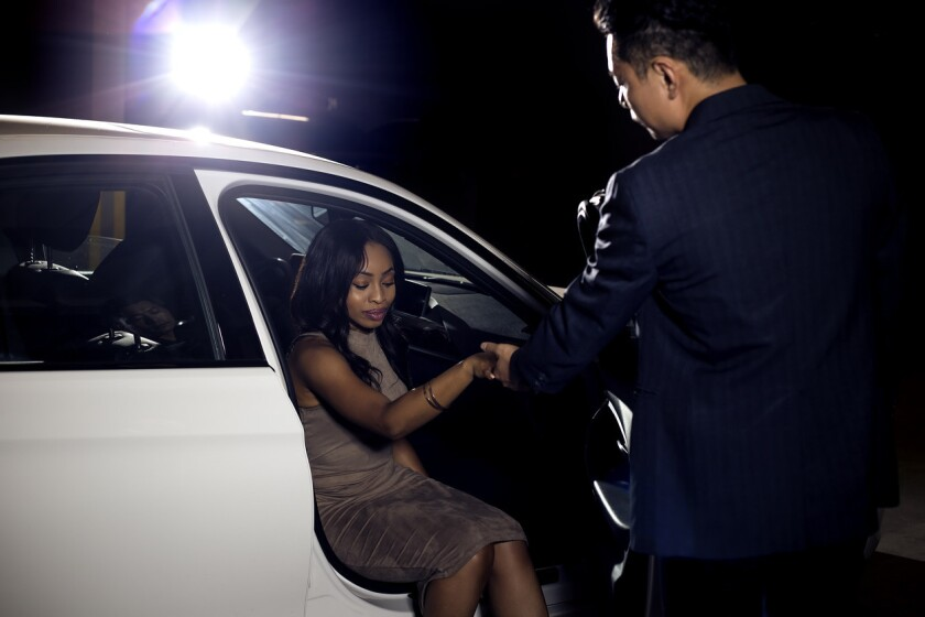 Gentleman Assisting Date Out of a Car