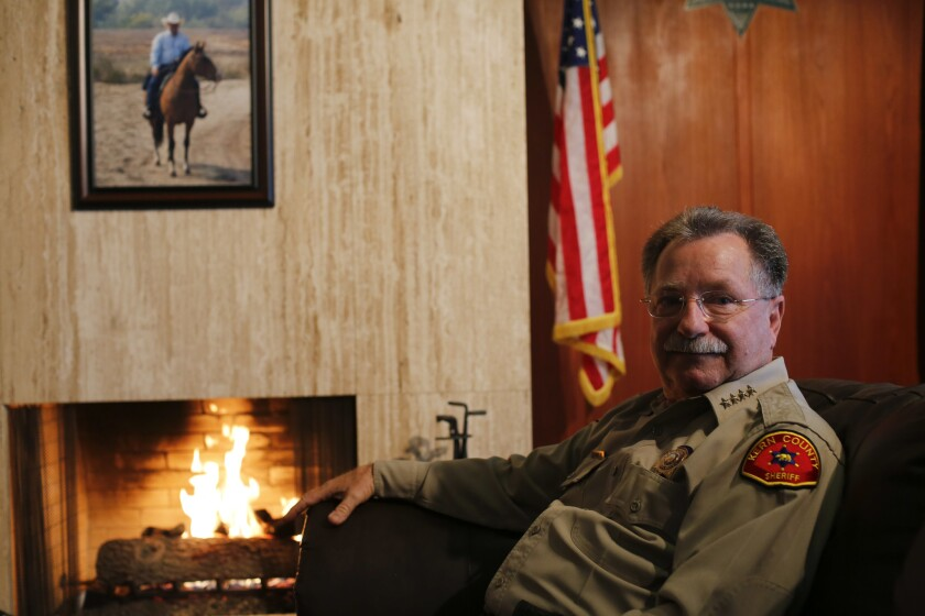 """Kern County Sheriff Donny Youngblood, shown here in his office, wants the county to be a """"law and order"""" county and is asking county supervisors to declare Kern a """"non-sanctuary"""" county."""