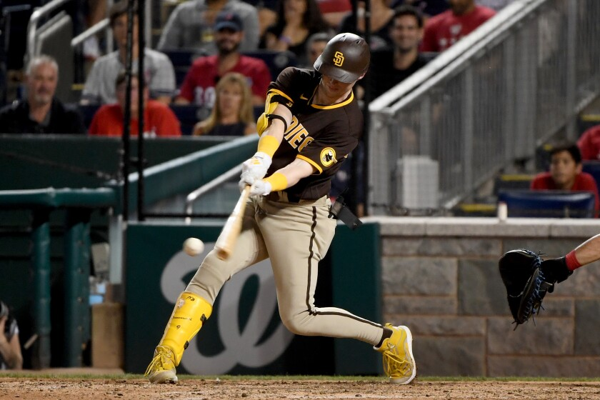 Jake Cronenworth hits a single during the sixth inning Friday to complete the cycle against the Washington Nationals.