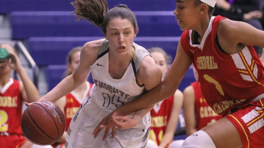 San Marcos' Sarah Cloutier (left, shown last season) was averaging 16.8 points this year before her injury.
