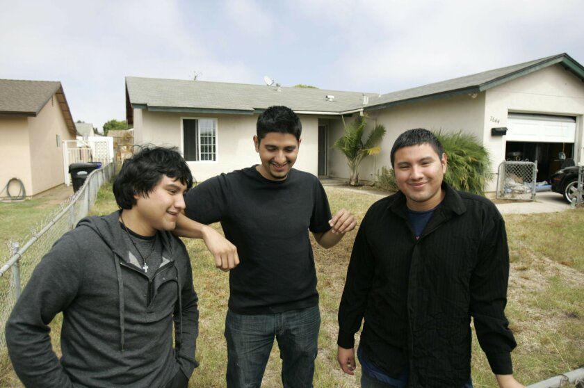 The three Robles brothers, from left, Juan, 22, Jose, 24, and Mario, 26, in front of their new home that brother Jose bought.