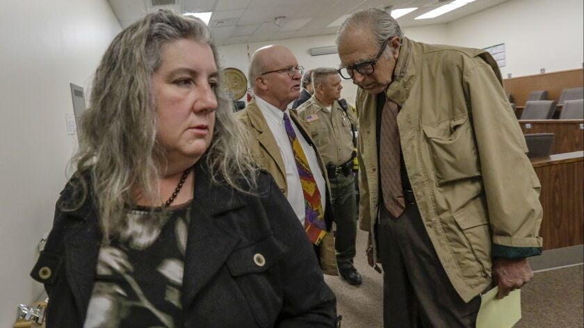 Mona Kirk, left, and Daniel Panico, a Joshua Tree couple accused of child abuse in March, appear in court Wednesday.